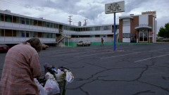 Hank takes Walt Jr. to a motel parking lot.