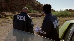 The DEA examines the cook site and the abandoned car.
