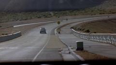 Walt drives on an empty road.