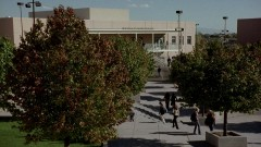 Exterior shot of the school, followed by Walt Jr. in Walt's class.