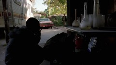 Walt gets a call from Gretchen while waiting outside Jesse's house.