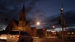 Timelapse of an intersection near a church.