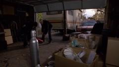 Walt and Jesse prepare at Jesse's house.