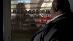 Some guy is trying to get into Saul's office.