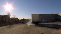 A truck takes away the barrel of corrosive material.