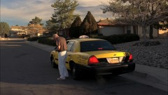 Walt takes a cab to his house.