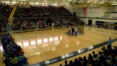 The whole school has a meeting in the gym.