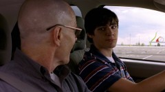 Walt is teaching Walt Jr. to drive.