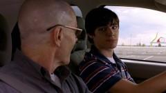 Walt is teaching Walt Jr. to drive.