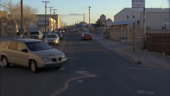 Walt rushes through town.
