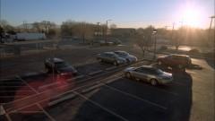 Walt arrives at Los Pollos' parking lot.