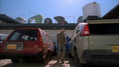 Walt leaves the laundromat.