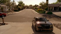 Walt and Walt Jr. arrive at home in their new cars.