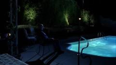 Skylar talks to Walt in the back yard.