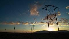 Timelapse of power lines running through the desert.