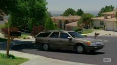 Saul watches Mrs. Kettleman leave her house.