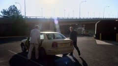 Mike and Saul walk to Saul's car.