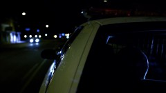 Two cops take Mike on a ride.