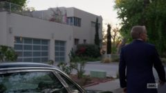 Howard parks his car in a residential area and climbs through several gardens