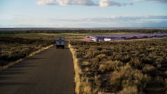 "A ""Los Pollos"" truck arrives at a plant