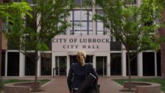 Kim goes to city hall at Lubbock